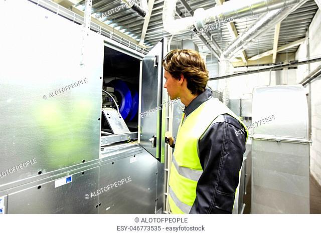 Worker in electrical switchgear room