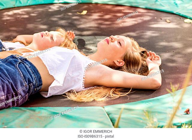 Girls lying down on trampoline