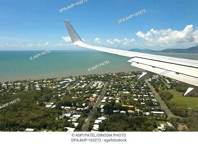 Aerial view of airplane approaching Cairns city ; Queensland ; Australia