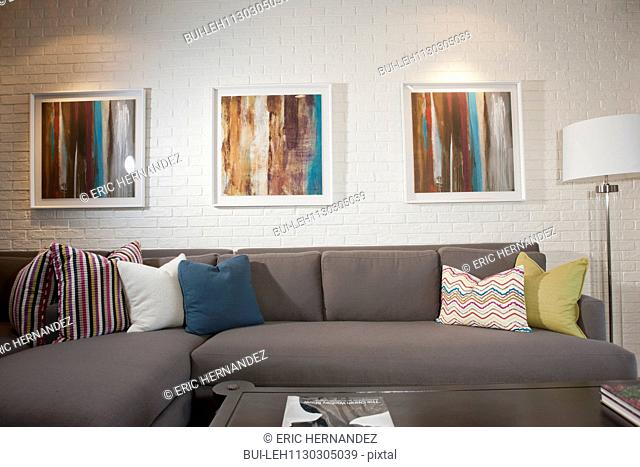 Sectional sofa and paintings in living room