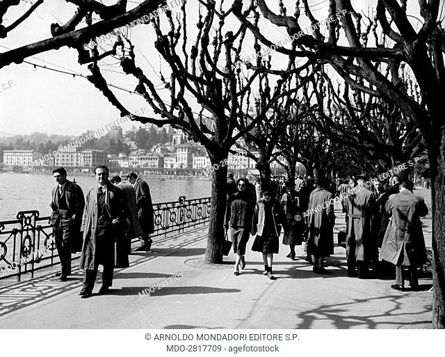 People walking along Riva Vincenzo Vela. Lugano, 28th March 1954