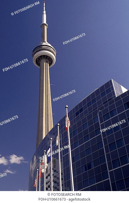 Toronto, Ontario, Canada, Flags fly in front of the Skydome Hotel and CN Tower in downtown Toronto
