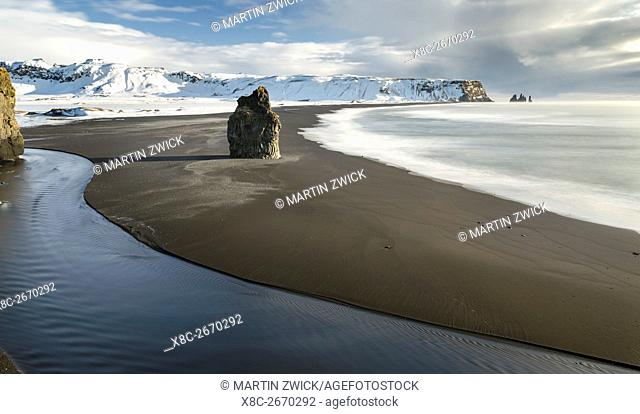 The famous black beach at the coast of the North Atlantic near Vik y Myrdal at sunrise. europe, northern europe, scandinavia, iceland, February