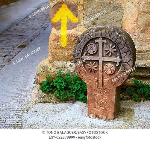 The way of Saint james yellow arrow sign in Cirauqui Pamplona Spain