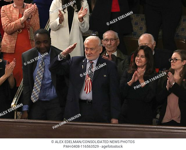 Former astronaut Buzz Aldrin salutes after being recognized as United States President Donald J. Trump delivers his second annual State of the Union Address to...