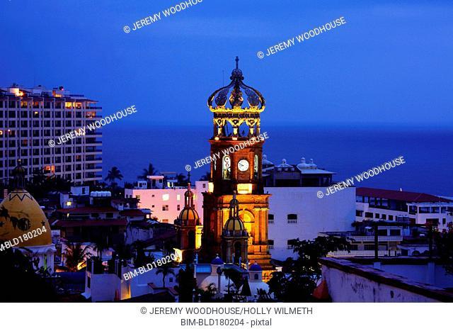 Illuminated tower in Puerto Vallarta cityscape, Jalisco, Mexico