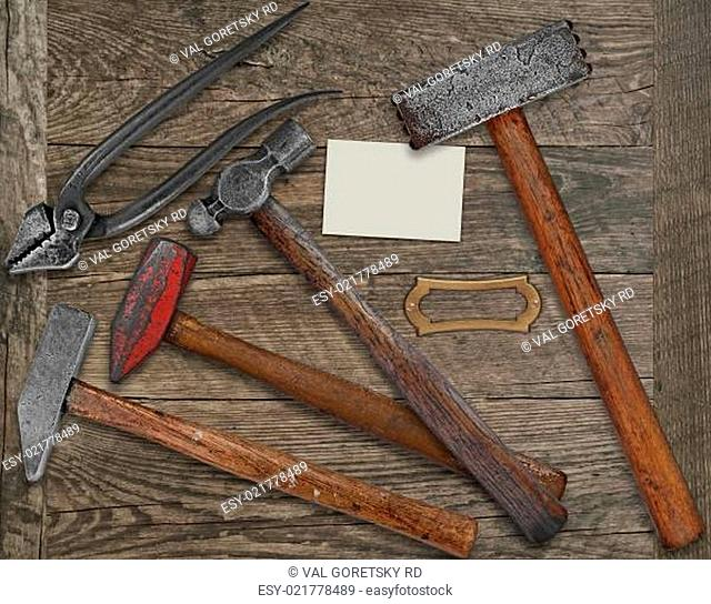 blacksmith tools and business card over bench