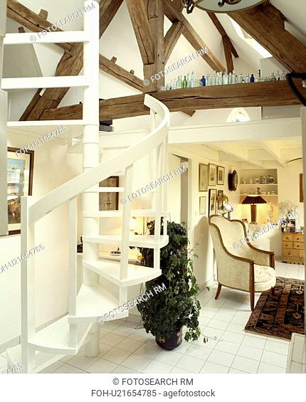 Spiral staircase in white country living room