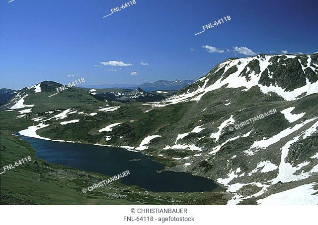 Lake surrounded by snowy mountain range, USA