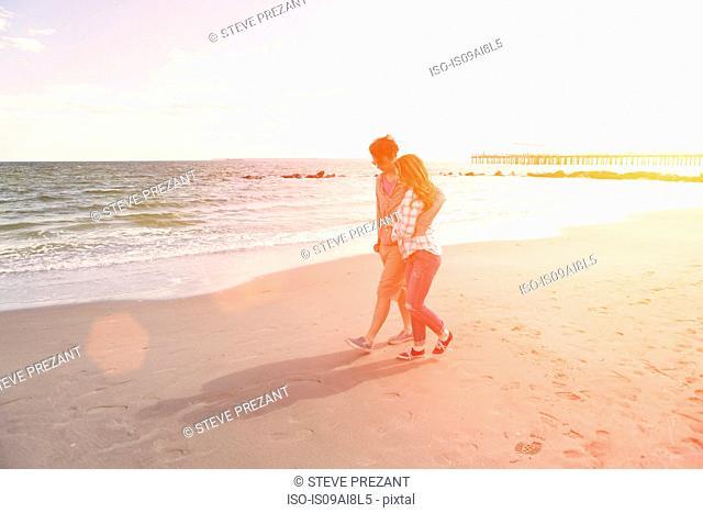 Romantic couple strolling on beach