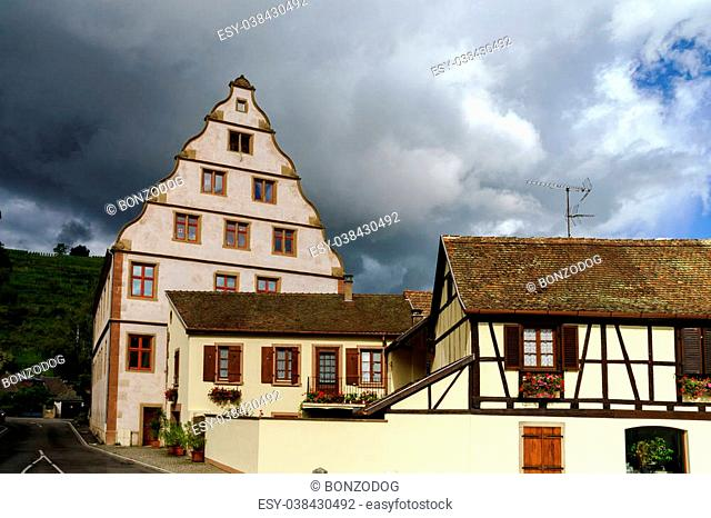 Old castle house in Andlau, Alsace, France, stormy weather