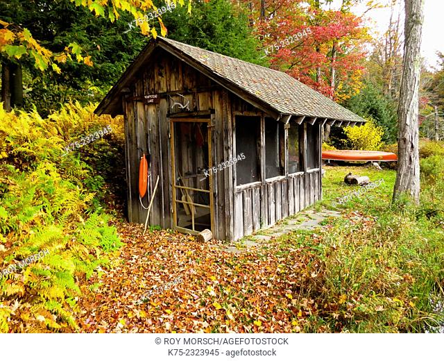 Lakeside shed in autumn