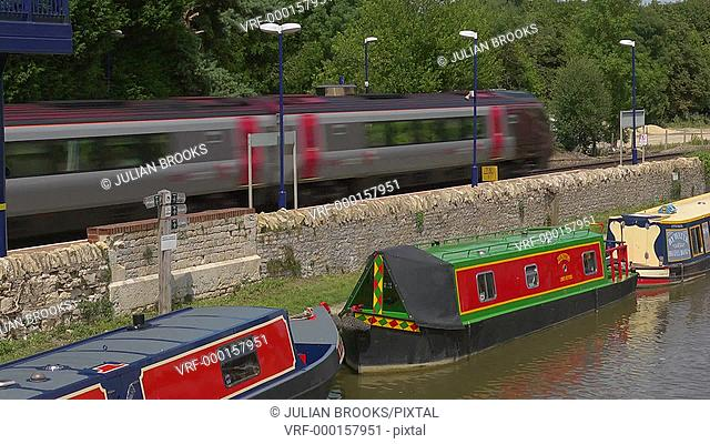 A Virgin express train speeding past the Oxford canal at Heyford
