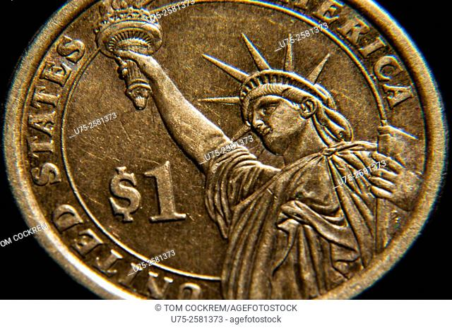 American one dollar Andrew Jackson tribute coin with Statue of Liberty in studio setting