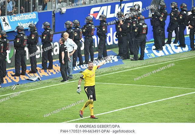 Regensburg's goalkeeper Philipp Pentke reacts in front of policecemen during the German Bundesliga 2nd division relegation soccer match between TSV1860 Munich...