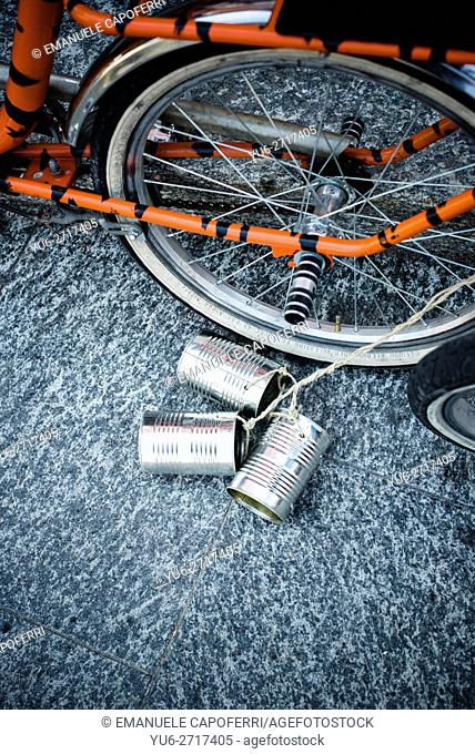 Rear bicycle wheel with attached cans for wedding