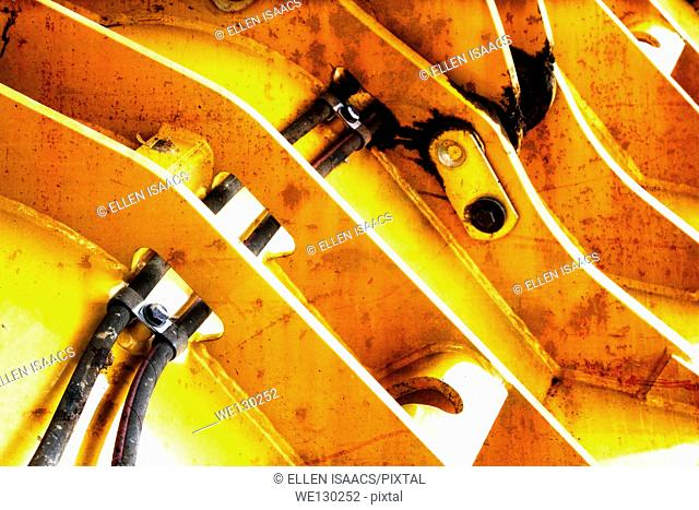 Closeup of hydraulics on a bulldozer with rust