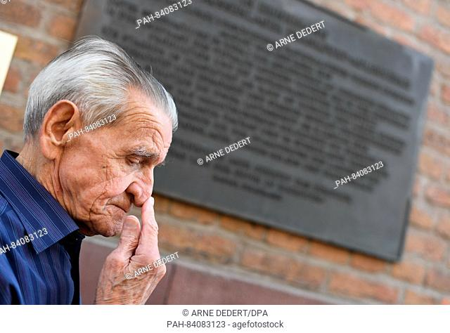 86-year-old concentration camp survivor Andrzej Branecki from Poland pictured next to a memorial plaque for the Frankfurt-Adlerwerke satellite concentration...