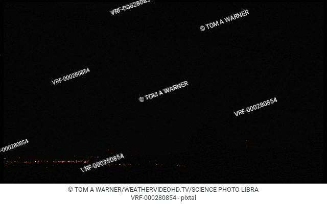 Upward lightning strikes propagating from tall TV towers at night. Filmed in South Dakota, USA, in summer