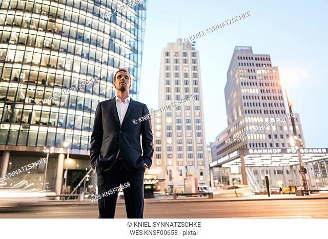 Germany, Berlin, Potsdamer Platz, businessman in the evening