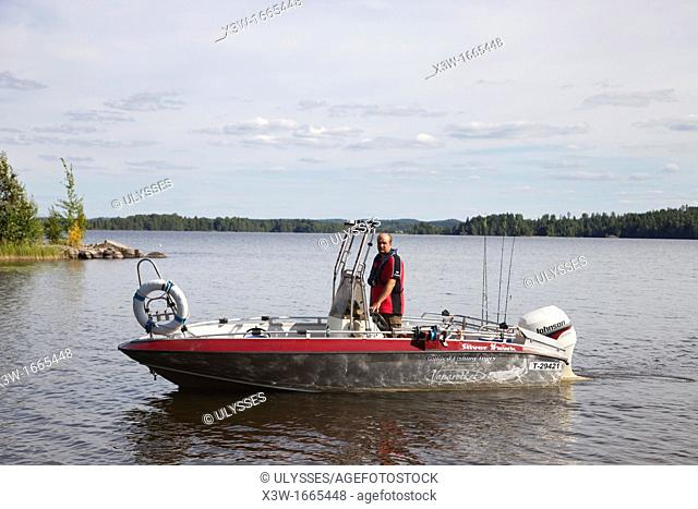 motorboat for fishing, rautavesi lake, vammala village, finland, europe