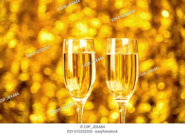 Two champagne glass on christmas bokeh background Two champagne glass on christmas bokeh background