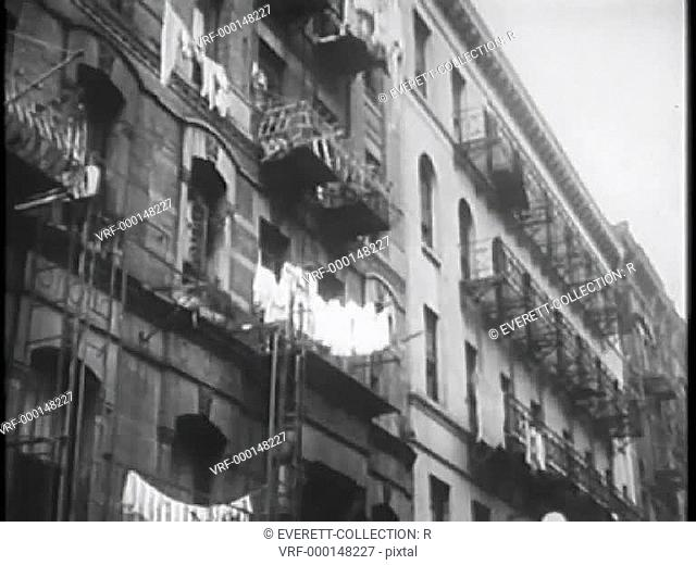 Laundry on clothesline hanging from tenement building