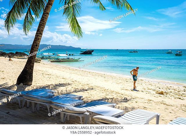 A man standing on Diniwid Beach, Boracay Island, Aklan Province, Western Visayas, Philippines