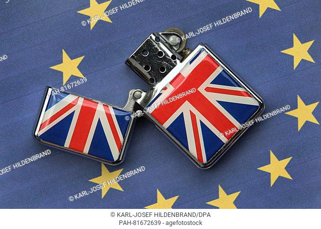 ILLUSTRATION - A lighter with the British flag printed on it lies on a European flag in Kempten, Germany, 29 June 2016. Photo: Karl-Joseph Hildenbrand/dpa |...