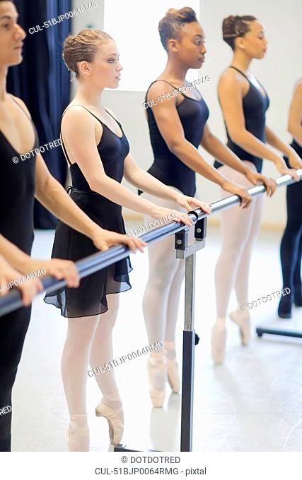 Ballet dancers practicing at barre