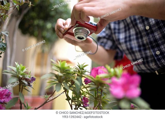 A blind student takes pictures of a plantduring a photography workshop for the blind and visually impaired, imparted by Sight of Emotion organization in Mexico...