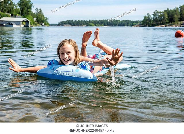 Happy girl on inflatable raft