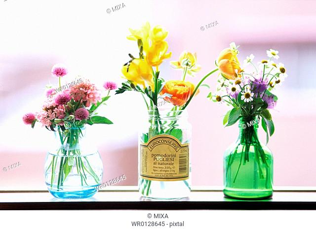 Three vases with flowers