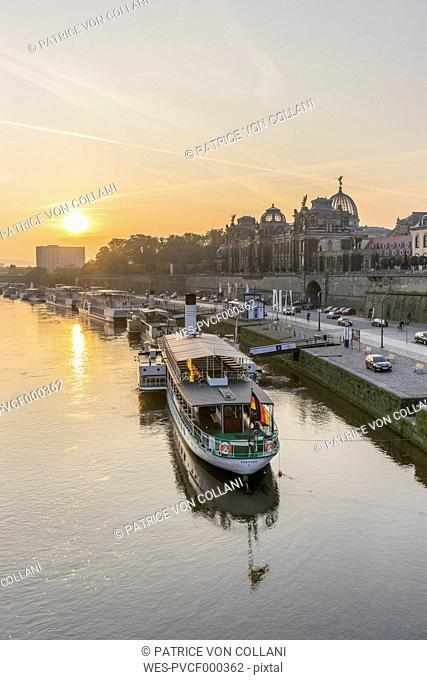 Germany, Dresden, view to Elbe River with moored steam boat at sunrise