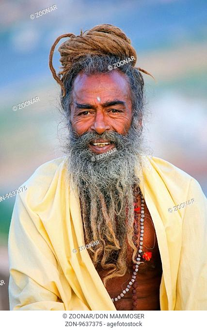 Portrait of a local man sitting near Galta Temple in Jaipur, India. Jaipur is the capital and largest city of the Indian state of Rajasthan