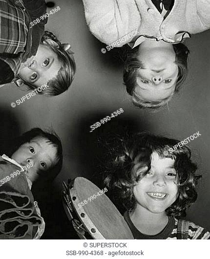 Low angle view of children holding a tambourine