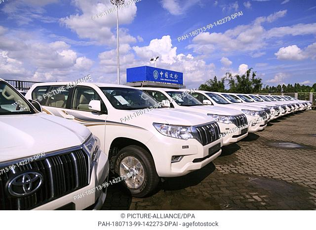 09 July 2018, China, Guangzhou: New Toyota Land Cruiser vehicles in a parking lot at the Nansha free trade zone at a China border agency checkpoint