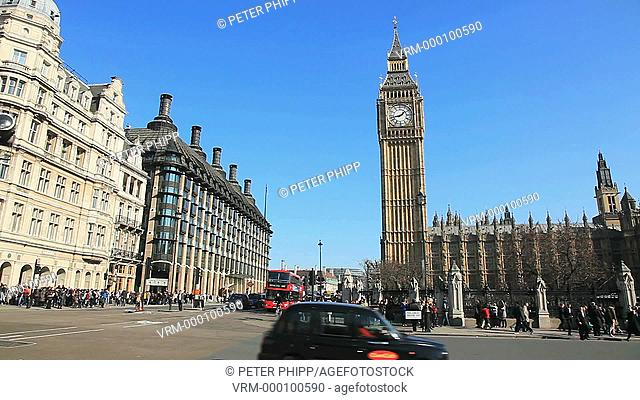 Westminster, with traffic and buses, and Big Ben and Houses of Parliament in London