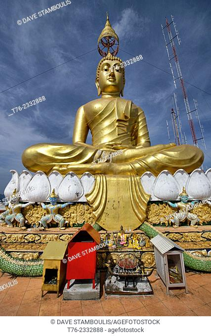 Golden Buddha on top of Wat Tham Sua Tiger Cave Temple in Krabi, Thailand