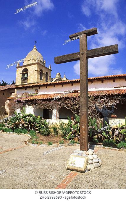 Wooden cross and Father Serra statue in the main courtyard at Mission San Carlos Borromeo de Carmelo (2nd California Mission), Carmel, California USA