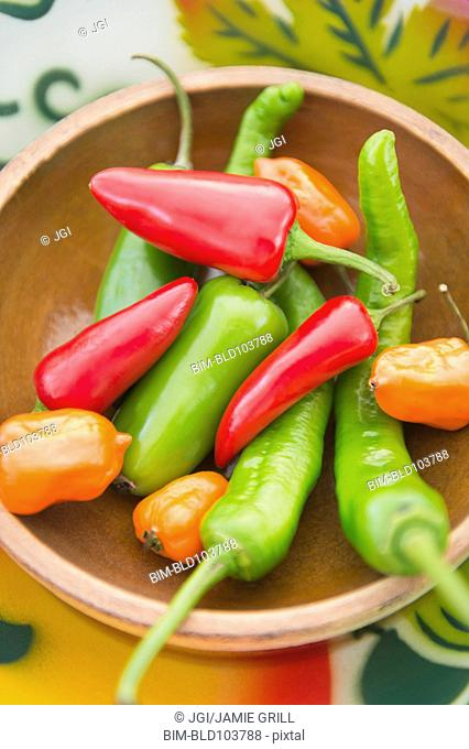 Colorful chili peppers in bowl