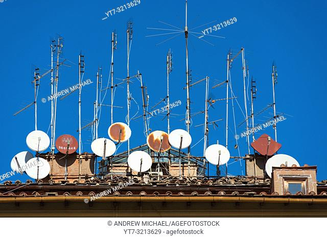 Rusty old aerials and satellite dishes on a building in Trastevere, Rome, Italy