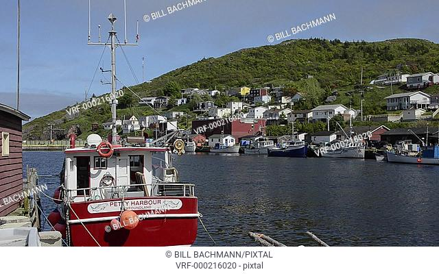 Newfoundland Canada St Johns capital at famous Petty Harbour with colorful ships in water