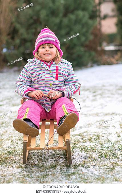 Girl with sleds in winter