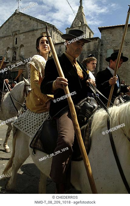 Two young couples riding horses, Provence, France