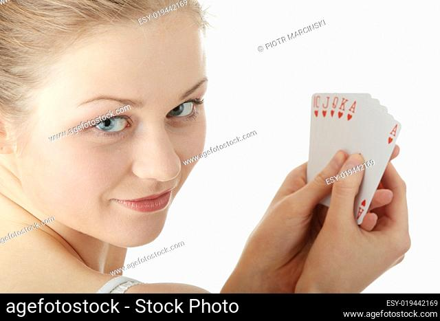 Young blond woman playing cards