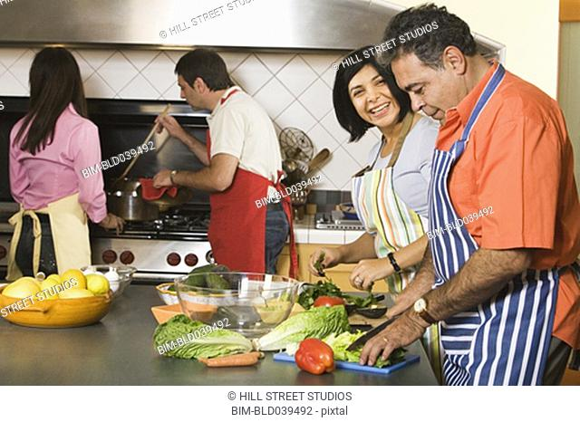Group of middle-aged friends cooking