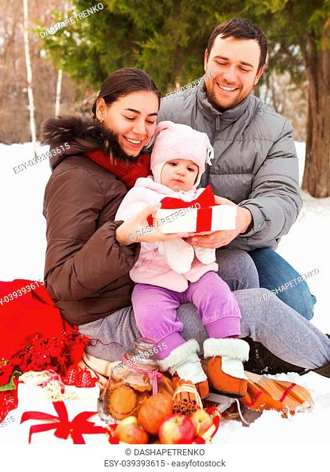 Happy smiling family with at the winter picnic outdoors