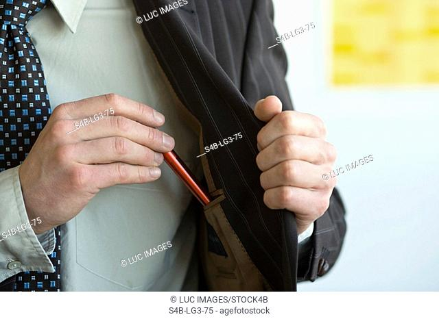 Man taking a pen out of his inside pocket