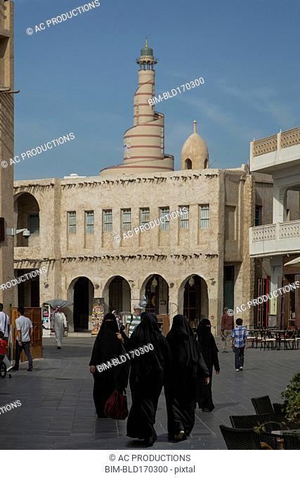 Women in hijab walking in Doha square, Doha, Qatar